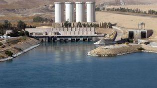 Le porte-parole des forces kurdes peshmergas qui contrôlaient le barrage de Mossoul (Irak) a confirmé, vendredi 8 août, la prise de l'installation par les jihadistes. (AHMAD AL-RUBAYE / AFP)