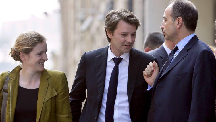Nathalie Kosciusko-Morizet,Francois Baroin etJean-Francois Copé, le 20 juin 2012 à Paris pour l'élection du président du groupe UMP à l'Assemblée. (KENZO TRIBOUILLARD / AFP)