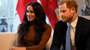 Meghan Markle et le prince Harry lors d'une visite auHaut-commissariat du Canada au Royaume-Uni, le 7 janvier 2020, à Londres. (DANIEL LEAL-OLIVAS / AFP)