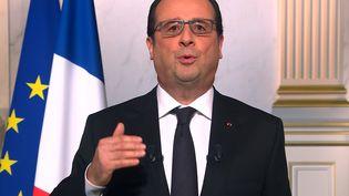 François Hollande prononce ses vœux aux Français, le 31 décembe 2015. (STRINGER / AFP)