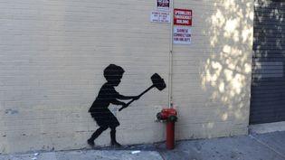 Un graffiti deBanksy sur un mur de New York  (Dennis Van Tine/Geisler-Fotopres / Geisler-Fotopress / Picture-Alliance/AFP)