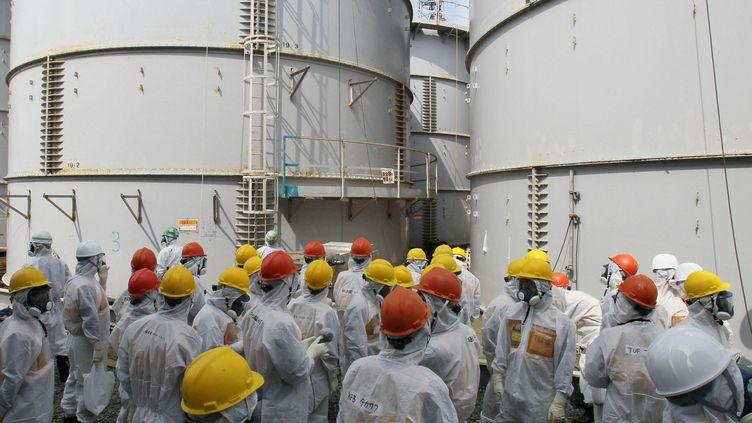 Des employés de Tepco à Fuskushima (Japon), le 13 septembre 2013. (KYODO KYODO / REUTERS)