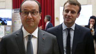 François Hollande et Emmanuel Macron, le 23 mai 2016, au palais de l'Elysée, à Paris. (CHARLES PLATIAU / AFP)