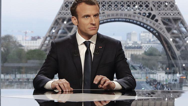 Le président de la République, Emmanuel Macron, lors de son interview sur Mediapart et BFMTV, le 15 avril 2018 à Paris. (FRANCOIS GUILLOT / AFP)
