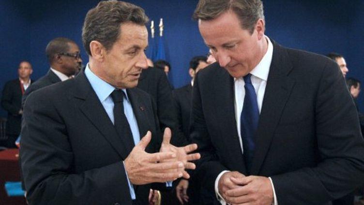Nicolas Sarkozy et le Premimer ministre britannique David Cameron, le 1er septembre 2011 à Paris. (PATRICK KOVARIK / AFP)