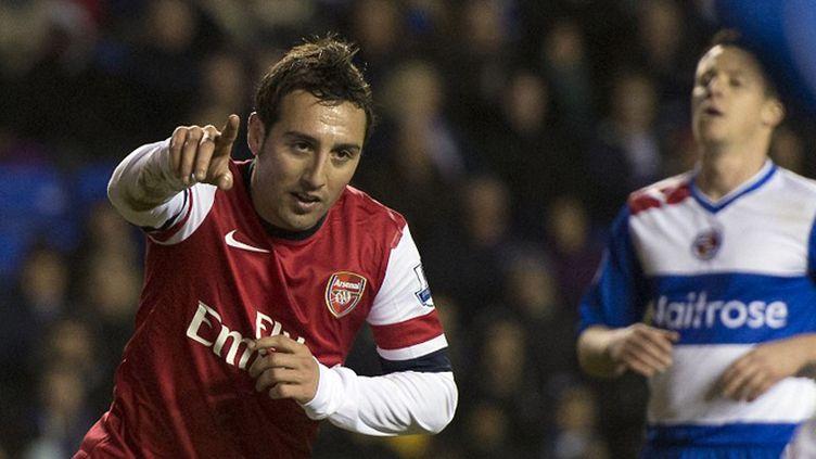 Santi Cazorla, auteur d'un triplé avec Arsenal face à Reading, est plus que jamais le joueur clé des Gunners.  (ADRIAN DENNIS / AFP)
