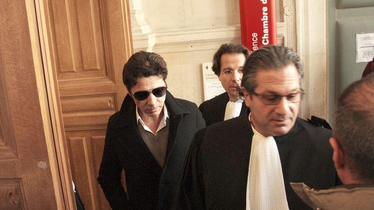 Le chanteur Jean-Luc Lahaye arrive au tribunal correctionnel de Paris, le 23 mars 2015. (PATRICE PIERROT / CITIZENSIDE.COM / AFP)