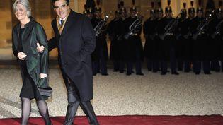 François Fillon et son épouse, Pénélope, à l'époque où il était Premier ministre. (LIONEL BONAVENTURE / AFP)