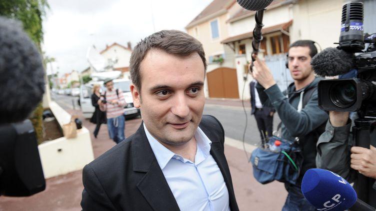 Le vice-président du FN, Florian Philippot, arrive au siège de son parti, le 26 mai 2014 à Nanterre (Hauts-de-Seine) (STEPHANE DE SAKUTIN / AFP)