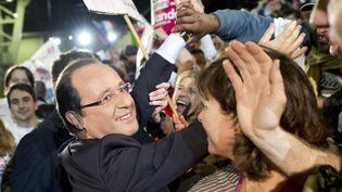 François Hollande à la sortie de son metting du Bourget, le dimanche 22 janvier 2012. (FRED DUFOUR / REUTERS)