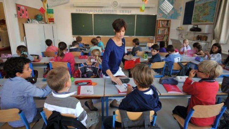 Retour en classe pour plus de 12 millions d'élèves ce lundi matin. (FRANK PERRY / AFP)