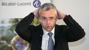 Le directeur général d'Alcatel-Lucent, Michel Combes, lors d'une conférence de presse à Paris, le 6 février 2015. (JACQUES DEMARTHON / AFP)