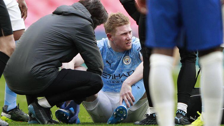 Kevin de Bruyne est sorti blessé face à Chelsea, le 17 avril 2021 (IAN WALTON / POOL)