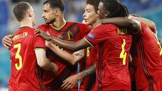 La Belgique libérée après une erreur du gardien finlandais. (ANATOLY MALTSEV / POOL)