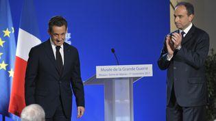 Nicolas Sarkozy et Jean-François Copé, le 11 novembre 2011 à Meaux (Seine-et-Marne). (PHILIPPE WOJAZER / POOL)