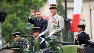 Emmanuel Macron lors du défilé du 14-Juillet sur les Champs-Elysées, le 14 juillet 2019. (ELIOT BLONDET / AFP)
