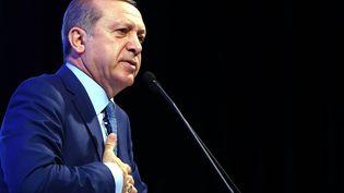 Le président turc Recep Tayyip Erdogan prononce un discours le 8 mars 2016 à Ankara à l'occasion de la journée internationale des droits des femmes. (KAYHAN OZER / ANADOLU AGENCY/AFP)