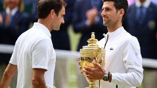 Le Serbe Novak Djokovic a remporté la dernière édition de Wimbledon, le 14 juillet 2019, face au Suisse Roger Federer. (DANIEL LEAL-OLIVAS / AFP)
