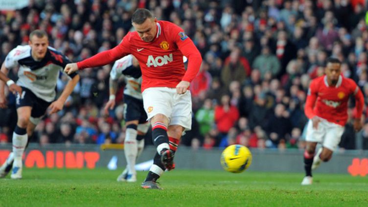Rooney tente sa chance (ANDREW YATES / AFP)