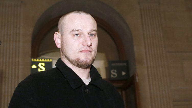 Marc Machin arrive au palais de justice de Paris, le 20 décembre 2012, au quatrième jour deson procès en révision. (PATRICK KOVARIK / AFP)