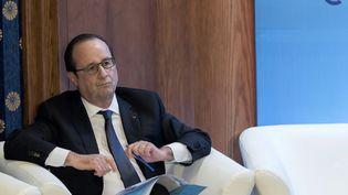 Le président François Hollande assiste à un forum économique à Amman (Jordanie), le 19 avril 2016. (JACQUES WITT / AFP)