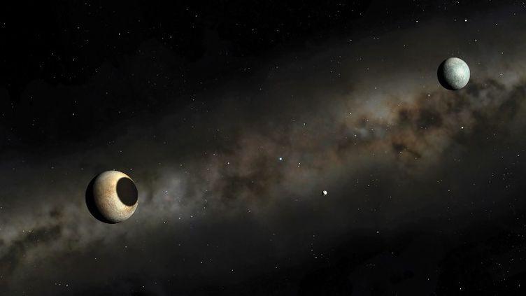 Un dessin d'artiste représentant Pluton et sa lune Charon, daté du 30 janvier 2013. (MGA / SCIENCE PHOTO LIBRARY / AFP)