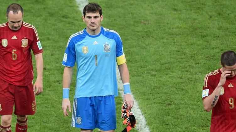 Andres Iniesta, Iker Casillas et Fernando Torres après la défaite contre le Chili au Mondial 2014