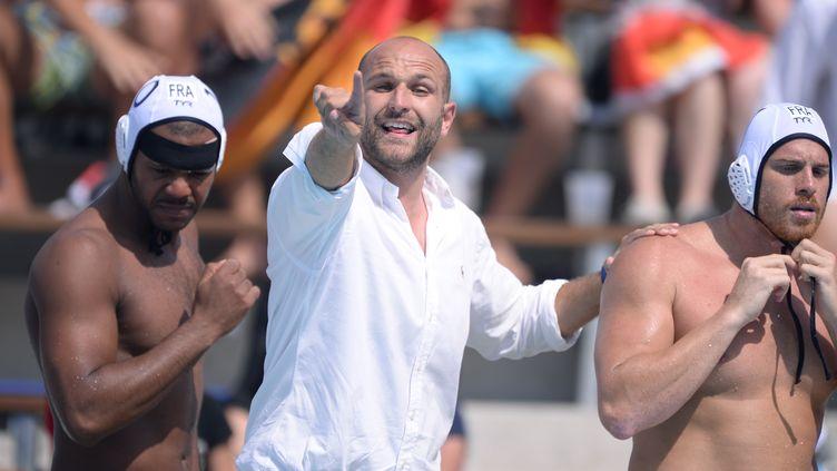 Le sélectionneur de l'équipe de France de water-polo, Florian Bruzzo (ATTILA KISBENEDEK / AFP)