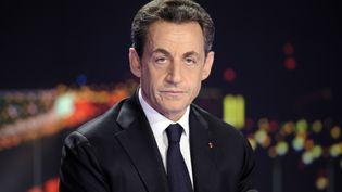 L'ancien président Nicolas Sarkozy sur le plateau de TF1, le 15 février 2012. (LIONEL BONAVENTURE / POOL)