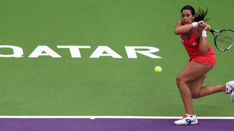Marion Bartoli s'est qualifiée pour le deuxième tour du Tournoi de Doha (KARIM JAAFAR / AFP)