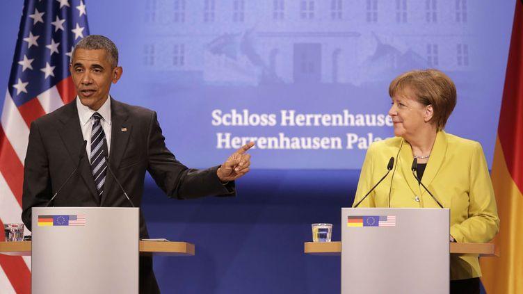 (Barack Obama et Angela Merkel soutiennent le Tafta à Hanovre © SIPA/Markus Schreiber)