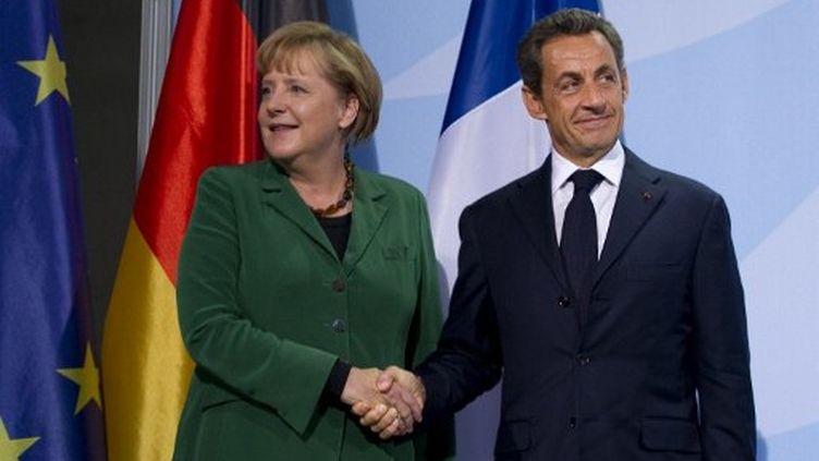 Nicolas Sarkozy et Angela Merkel, le 9 octobre 2011 à Berlin. (JOHANNES EISELE / AFP)