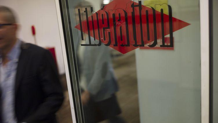 """La rédaction de """"Libération"""", à Paris, le 3 septembre 2013. (FRED DUFOUR / AFP)"""
