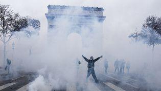 L'Arc de Triomphe, théâtre et victime de violentes émeutes le 1er décembre 2018  (Yann Castanié / Hans Lucas / AFP)