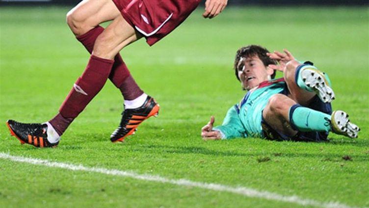 Messi au sol (ALEXANDER NEMENOV / AFP)