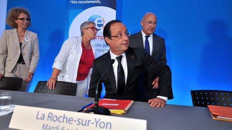 Le chef de l'Etat, François Hollande, en déplacement à La Roche-sur-Yon, en Vendée, le 6 août 2013. (FRANK PERRY / AFP)