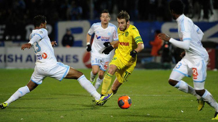Lucas Deaux (Nantes) prend de vitesse les Marseillais (BORIS HORVAT / AFP)