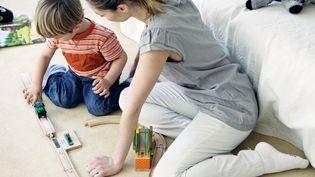 L'application de la réforme des rythmes scolaires à la rentrée 2014 pourrait provoquer une augmentation généralisée des tarifs de garde d'enfants, selon Yoopies. (B. BOISSONNET / BSIP / AFP)