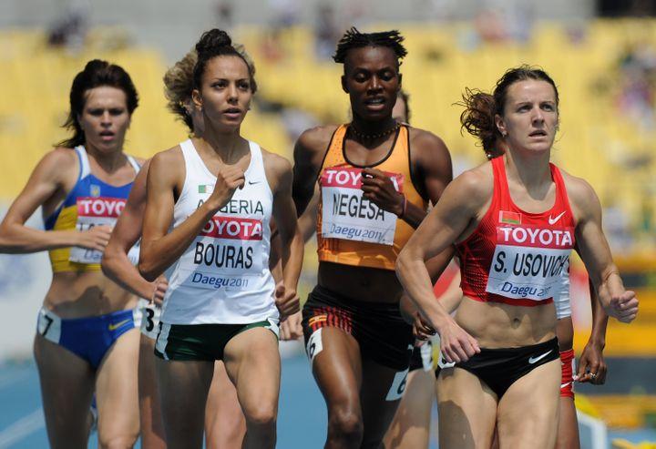 Annet Negesa, au centre, lors des Championnats du monde d'athlétisme à Daegu (Corée du Sud), le 1er septembre 2011. (OLIVIER MORIN / AFP)