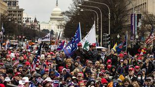 Des partisans de Donald Trump défilent à Washington (Etats-Unis), le 5 janvier 2021. (SAMUEL CORUM / GETTY IMAGES NORTH AMERICA / AFP)