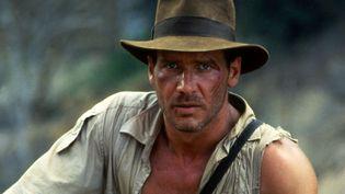 """Harrison Ford et son fameux chapeau dans """"Indiana Jones et le temple maudit"""" (1984) (LUCASFILM / COLLECTION CHRISTOPHEL VIA AFP)"""
