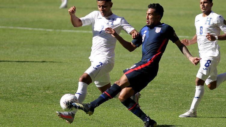 Les États-Unis face au Honduras lors du match pour les qualifications olympiques, le 28 mars 2021.  (ULISES RUIZ / AFP)