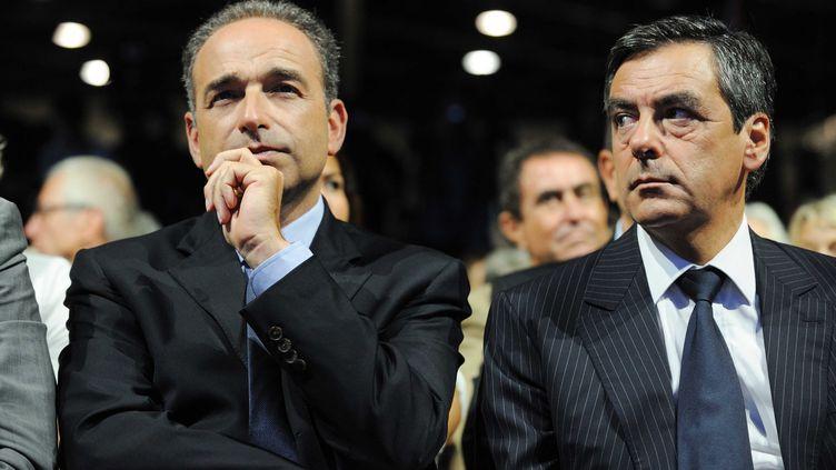 Le secrétaire général de l'UMP, Jean-François Copé, et l'ancien Premier ministre, le 4 septembre 2011 au campus de l'UMP à Marseille (Bouches-du-Rhône). (WITT / SIPA)