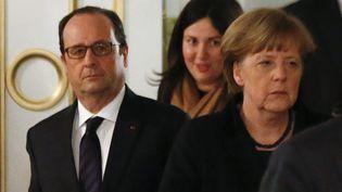 François Hollande et Angela Merkel à l'issue des négociations sur l'Ukraine, à Minsk (Biélorussie), jeudi 15 février 2015. ( VASILY FEDOSENKO / REUTERS)