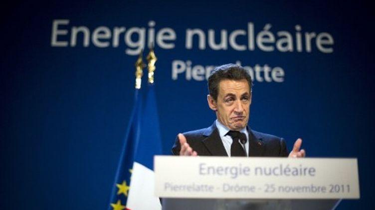 Nicolas Sarkozy lors de son déplacement dans la Drôme le 25 novembre. (LIONEL BONAVENTURE / POOL / AFP)