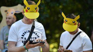 Des visiteurs au festival Pokémon GO, le 4 juillet 2019, à Dortmund (Allemagne). (INA FASSBENDER / AFP)