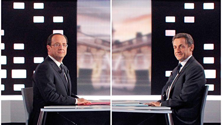 François Hollande et Nicolas Sarkozy sur le plateau du débat de l'entre-deux-tours de la présidentielle, le 2 mais 2012. (PATRICK KOVARIK / POOL)