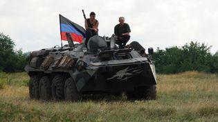 Des membres du groupe de défense de la République autoproclamée de Donetsk, dans l'est de l'Ukraine, le 9 juillet 2014. (GENNADY DUBOVOY / RIA NOVOSTI / AFP)