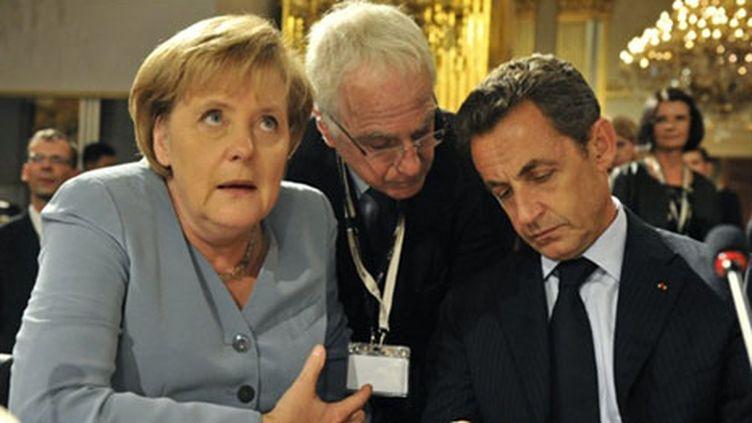 Nicolas Sarkozy et Angela Merkel, à Bruxelles, au huitième sommet Asie-Europe, le 4/10/2010 (AFP/Georges Gobet)
