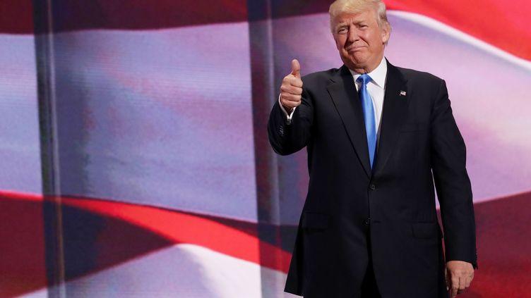 Le milliardaire Donald Trump sur la scène de la convention du parti républicain, à Cleveland (Ohio, Etats-Unis), le 18 juillet 2016. (CHIP SOMODEVILLA / GETTY IMAGES NORTH AMERICA / AFP)